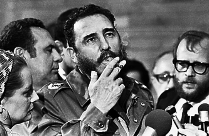 Then Cuban Prime Minister Fidel Castro smokes a cigar during interviews with the press during a visit of U S  Senator Charles McGovern  in Havana in this May 1975 file photo  REUTERS Prensa Latina File Photo